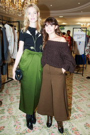 Natalia Vodianova chose a long green skirt to pair with her top.