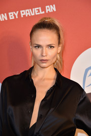 Natasha Poly highlighted her chiseled features by pulling her hair away from her face in a tight ponytail during the Buro 24/7 Fashion Forward Initiative.