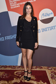 Julia Restoin-Roitfeld injected some sexiness with an asymmetrical mini skirt.