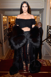 Kim Kardashian kept the fierceness coming with a pair of black lace-up leather pants by Unravel.