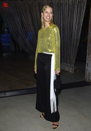 Karolina Kurkova lit up the #BoF500 2018 with this yellow sequined blouse by Galvan.