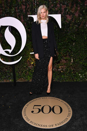 Karlie Kloss kept it on the casual side in a black blazer layered over a white crop-top at the #BoF500 gala.
