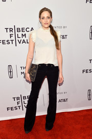 Carly Chaikin balanced out her girly top with edgy bootcut jeans by Rag & Bone.