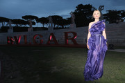 Sylvia Hoeks got dolled up in a one-shoulder ruffle gown by Ermanno Scervino for the Bvlgari dinner and party in Rome.