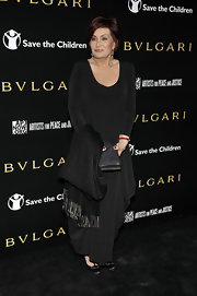 Sharon Osbourne complemented her sleek black look with a glittery black hard case clutch.