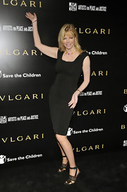Cheryl Tiegs looked ageless in strappy ankle strap heels, which perfectly accented a black bodycon dress.