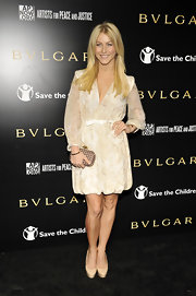 Julianne looked perfectly feminine in nude platform pumps.