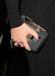 The gold hardware on Olivia Wilde's black satin clutch gave it a distinctly Art Deco flair.