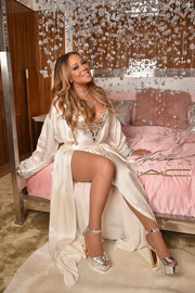 Mariah Carey went boudoir-glam in a white silk robe layered over a plunging bodysuit for the launch of her M.A.C. Cosmetics Beauty Icon collection.