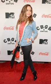 Eliza Dushku teamed black ankle boots with skinny jeans and a denim jacket for her casual red carpet look during the 'CBGB' premiere in New York.