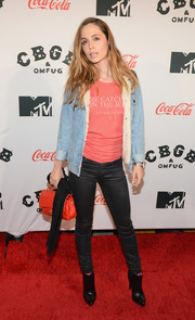 Eliza Dushku opted for a casual look with a pair of gray skinny jeans and a denim jacket when she attended the 'CBGB' premiere in New York.