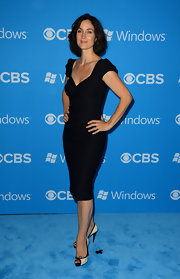 Carrie-Anne Moss styled her sleek and chic LBD with black-and-white peep-toe Christian Louboutin pumps.