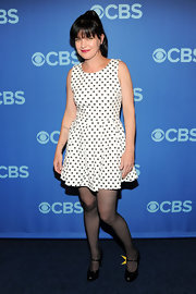Pauley Perrette opted for a fun retro-style look with this white A-line that featured black polka-dots.