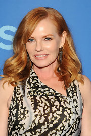 Marg Helgenberger chose a soft but voluminous wave to show off her shiny strawberry locks.