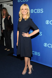 Sarah Michelle Gellar rocked a totally sophisticated look when she wore this dark navy three quarter-length A-line.