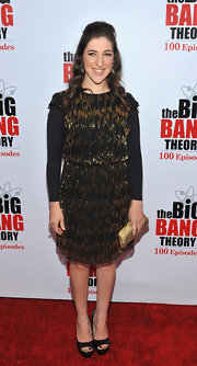 Mayim Bialik wore a gold and black cocktail dress with a sheen for the 'Big Bang Theory' celebration.