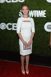 Katherine Heigl paired her stylish dress with a printed box clutch by Lee Savage.