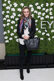Keltie Knight was business-chic in a black tweed jacket, which she styled with a colorful scarf, at the Eye Speak Summit.