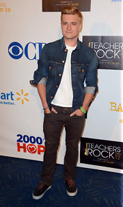 Josh Hutcherson kept his look low-key, matching his brown skinnies with leather lace-up sneakers.