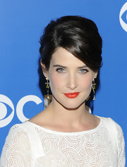 Cobie Smulders enlivened her look with a vibrant citrus-hued lipstick for the CBS 2012 Upfronts.
