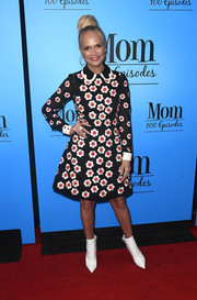 Kristin Chenoweth styled her cute frock with a pair of white ankle boots.