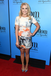 Emily Osment styled her dress with trendy silver pumps.
