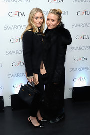 Ashley Olsen showed off her glamorous side with this black wool coat with fur trim.