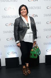Patty Perreira dressed down her leather jacket by pairing it with a white blouse and black capris.