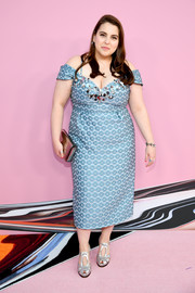 Beanie Feldstein pulled her look together with a metallic silver clutch.