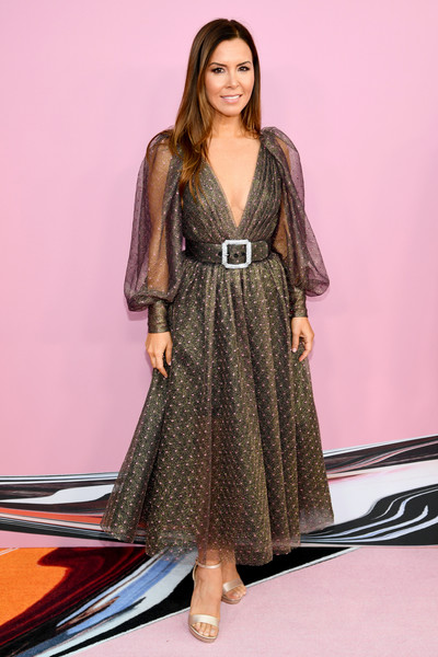Monique Lhuillier cut a chic figure in a plunging gray cocktail dress from her eponymous label at the 2019 CFDA Fashion Awards.