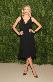 Lily Donaldson opted for a pair of leopard-print pumps to complete her ensemble.