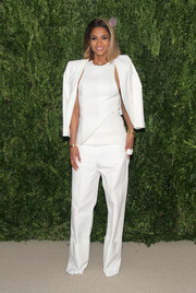 Ciara looked super stylish in a white pantsuit by Calvin Klein during the Fashion Fund finalists celebration.