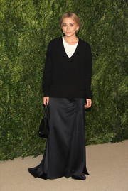 No one can pull off the V-neck-sweater-over-an-evening-dress look like Mary-Kate Olsen can.