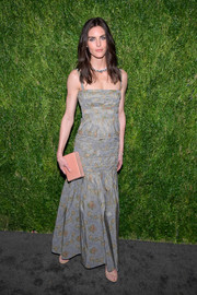 Hilary Rhoda paired her frock with a nude box clutch by Hunting Season.