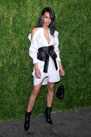 Chanel Iman tied her look together with a black velvet pouch.