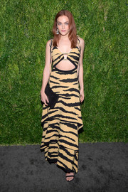 Madeline Brewer finished off her outfit with a simple black suede clutch.
