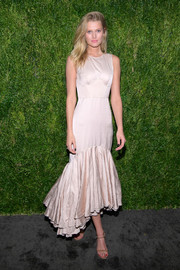 Toni Garrn oozed feminine charm wearing this champagne Brock Collection corset dress with a mermaid hem at the CFDA/Vogue Fashion Fund 15th anniversary event.