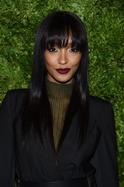 For her beauty look, Jourdan Dunn went vampy with a sweep of dark red lipstick.