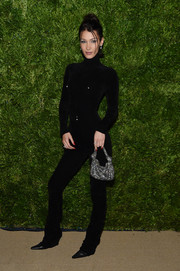 Bella Hadid brightened up her look with a beaded silver purse, also by Alexander Wang.