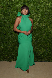 Kat Graham attended the 2019 CFDA/Vogue Fashion Fund Awards wearing a green mermaid gown by Christopher John Rogers.