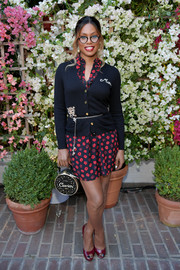 Laverne Cox layered a black cardigan over a floral shirtdress, both by Kate Spade, for the CFDA/Vogue Fashion Fund show and tea.