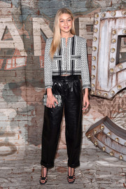Gigi Hadid went for a perfect evening look in a pair of baggy leather pants for a dinner hosted by Chanel.
