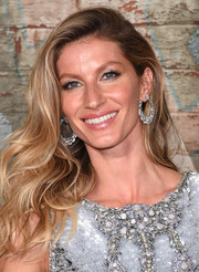 Gisele Bundchen sparkled in statement diamond hoops at a Chanel dinner.