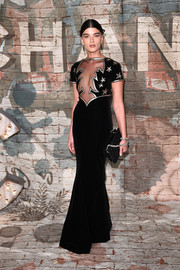Crystal Renn looked fit for the occasion in a dramatic Chanel gown with a sheer panel at a Chanel dinner.