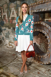 Harley Viera-Newton went down the casual route in a floral printed cardigan for a Chanel dinner.