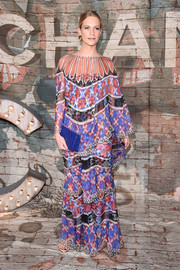 Poppy Delevingne wore a dreamy chiffon dress by Chanel featuring printed tiers at a Chanel dinner.