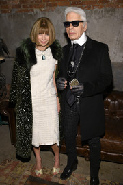 Anna Wintour paired a spotted fur coat with a tweed dress for the Chanel dinner.