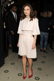 Keira Knightley added a pop of color with red Bionda Castana pumps at the Chanel dinner in honor of the 2014 Tribeca Film Festival.