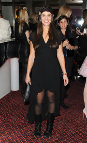 Margherita Missoni's black mid-calf boots were a tough-looking contrast to her delicate LBD at the Chanel dinner.