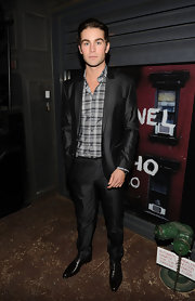 Chace Crawford showed off a sleek suit which he paired with a plaid button down shirt.
